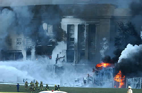 The Pentagon in flames moments after a hijacked jetliner crashed into the building Sept. 11, 2001. Photo by Cpl. Jason Ingersoll, USMC