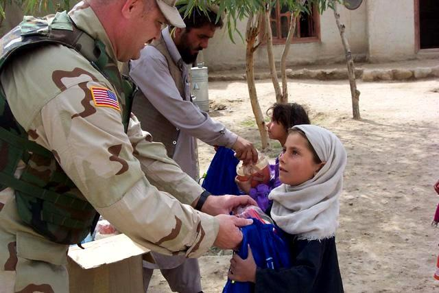 Civil affairs soldiers distribute BluePacks to school children in Jalalabad. (Photo courtesy of Civil Military Operations Center, Jalalabad)