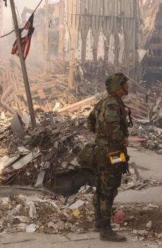 New York, NY, September 18, 2001 -- A soldier stops to view the wreckage of the World Trade Center. Photo by Andrea Booher/ FEMA News Photo