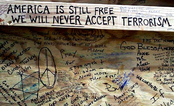 Someone wrote 'America is still free. We will never accept terrorism' on the back of the bulletin board at a spontaneous memorial that sprang up near the Pentagon to honor those killed in the terrorist attack there Sept. 11, 2001. Photo by Rudi Williams.