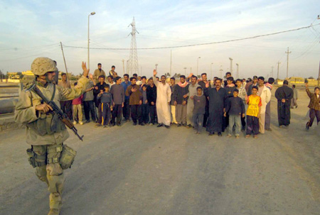 A U.S. Marine says goodbye after meeting Iraqi citizens from the city of Al Fay.  U.S. Marine Corps Photo Cpl. Mace M. Gratz