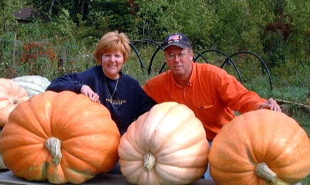 Bill and Lorraine Garvey with three of their prized pumpkins