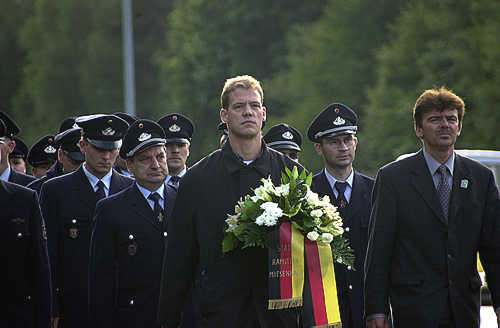 German citizens march from Ramstein Village, Germany to Ramstein AB, Germany on Sep 14, 2001, as a show of support for the victims of the terrorist attacks in the United States on Sep 11, 2001, and those who mourn them. Immediately following the march, wreaths, flowers, and candles are laid at the base of the sign at the west gate of base. U.S. Air Force Photo by Staff Sgt. P.J. Farlin